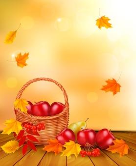 Sfondo autunnale con frutta fresca in cesto