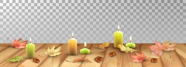 Sfondo autunnale con candele accese e foglie cadute sul pavimento in legno