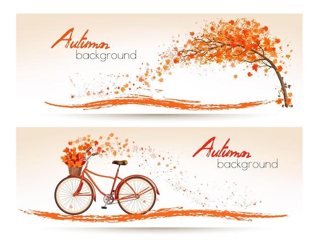Bandiere autunnali con alberi e una bicicletta. vettore.