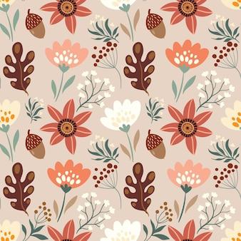 Modello senza cuciture decorativo autunnale con elementi floreali ghiande piante foglie e fiori