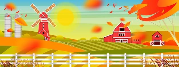 Paesaggio agricolo autunnale con sole, mulino, fienile, case del villaggio, recinzione, alberi rossi, foglie d'arancio