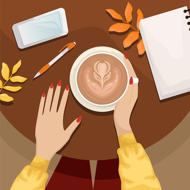 Autunno piatto giaceva con la ragazza seduta a un tavolo in un bar con una tazza di cappuccino
