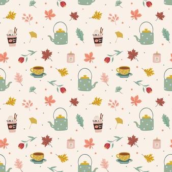 Autunno hygge seamless pattern con elementi come foglie, caffè, candele e bollitore.