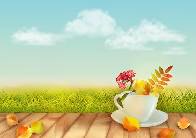 Paesaggio autunnale con una tazza piena di fiori autunnali