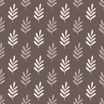 Reticolo senza giunte delle siluette dei rami delle foglie di autunno. grafica botanica stilizzata nei toni del beige e del marrone.