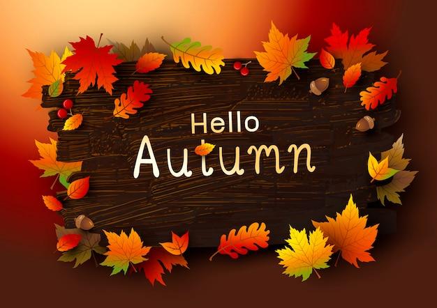 Foglie di autunno su fondo di legno marrone