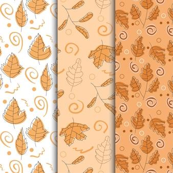 Collezione di sfondo senza soluzione di continuità con motivo autunnale con foglie autunnali disegnate a mano