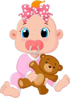 Baby boy con ciucci e giocattoli