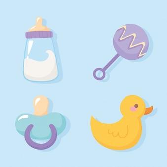 Baby shower, ciuccio sonaglio d'anatra e bottiglia di latte accolgono le icone della celebrazione del neonato