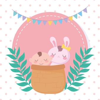 Baby shower, ragazzino e coniglio nel cestino, celebrazione benvenuto neonato
