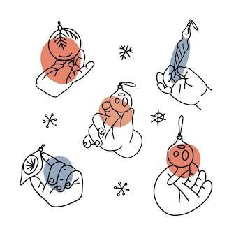 Mani del bambino che appendono palle e palline di natale insieme di illustrazioni lineari con forme astratte tagliate...
