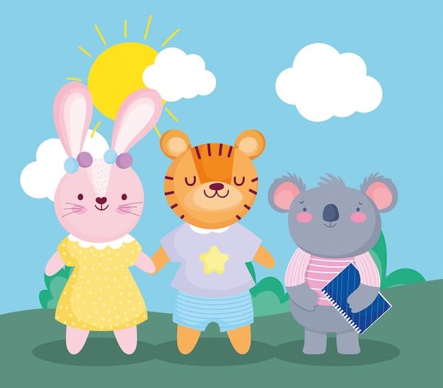 Ritorno a scuola, koala con libro e cartone animato coniglio tigre