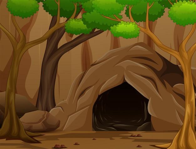 Scena di sfondo con una grotta scura e rocciosa