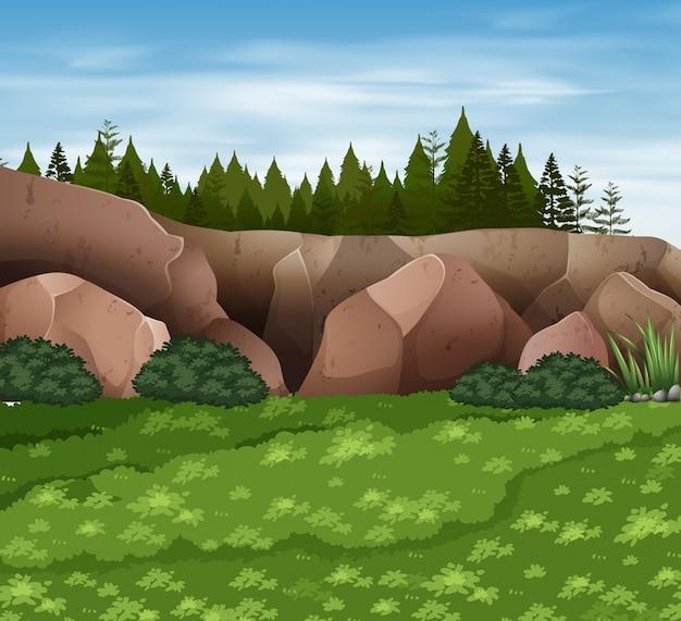 Scena di sfondo con rocce ed erba