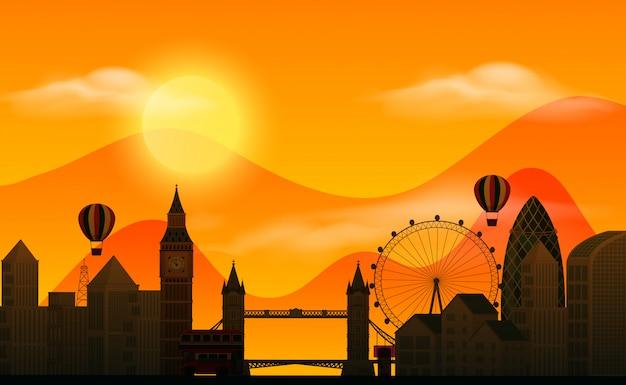 Scena del fondo con le costruzioni della siluetta e di tramonto nella città