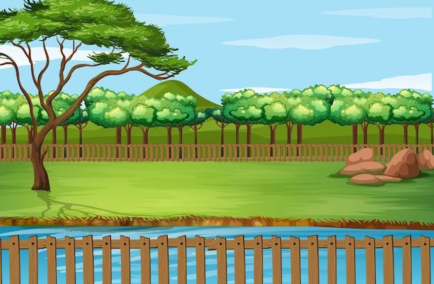 Scena di sfondo con staccionata in legno intorno al parco
