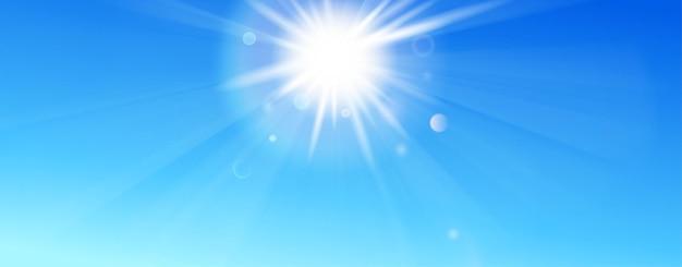 Sfondo con cielo azzurro, sole, raggi e riflesso lente