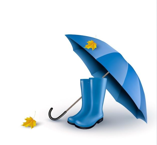 Sfondo con ombrello blu e stivali da pioggia.