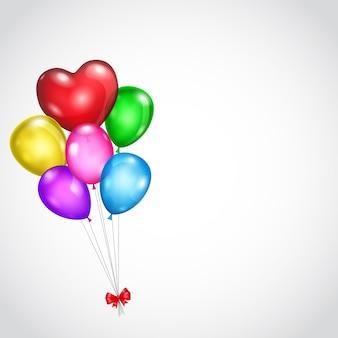 Sfondo con mazzo di palloncini colorati e fiocco rosso