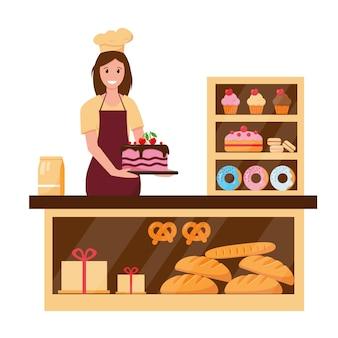 Donna panettiere nel negozio di panetteria con torte, pane e torte.