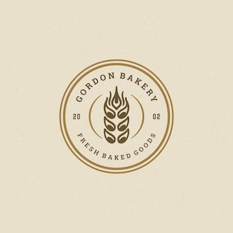 Siluetta del grano dell'orecchio dell'illustrazione di vettore del distintivo o di logo del retro forno Vettore Premium