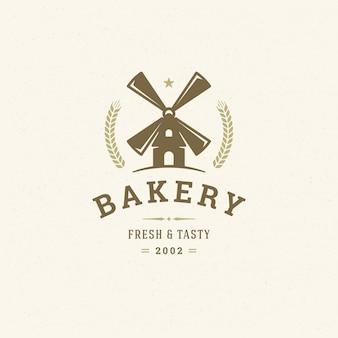 Siluetta d'annata del mulino dell'illustrazione di vettore del logo o del distintivo del forno per lo sho del forno