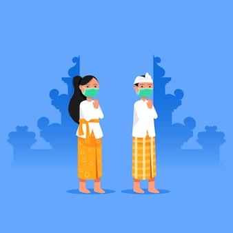 Bali un ragazzo e una ragazza danno il benvenuto durante l'era della pandemia