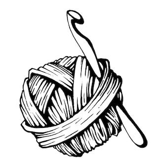 Un gomitolo di lana e un gancio