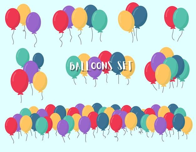 Palloncini di colore blu, rosso, viola, giallo. bouquet di palloncini multicolori per vacanze, compleanno, festa, matrimonio in stile piano isolato su priorità bassa bianca.