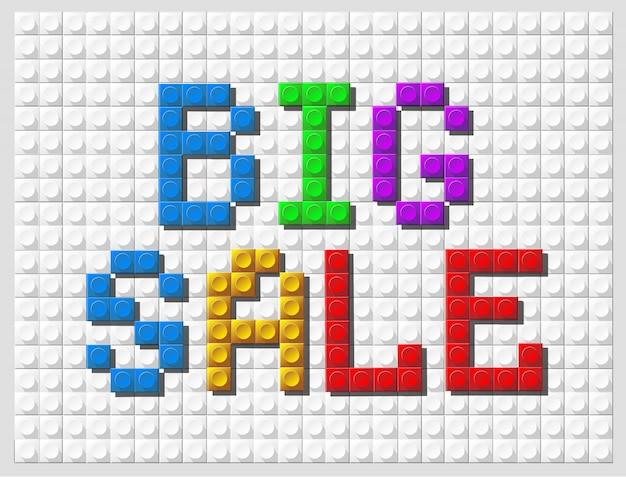 Grandi lettere di colore di vendita dell'insegna su fondo bianco