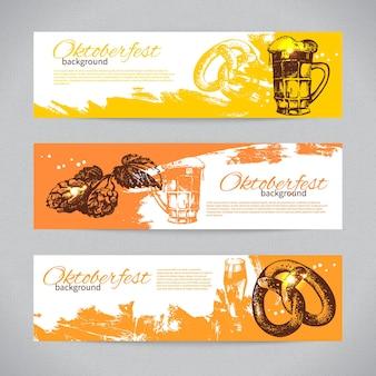 Banner di design della birra dell'oktoberfest. illustrazioni disegnate a mano. sfondi splash blob