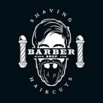 Logo del negozio di barbiere su sfondo scuro