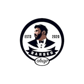 Design del logo del negozio di barbiere