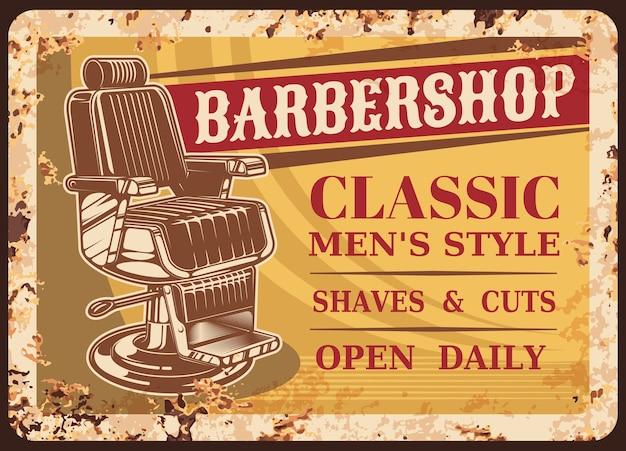 Piastra arrugginita in metallo del negozio di barbiere
