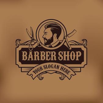 Design moderno del logo vintage del negozio di barbiere