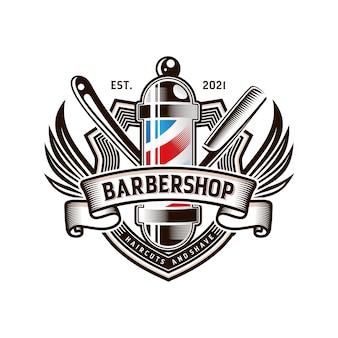 Design del logo vintage del negozio di barbiere