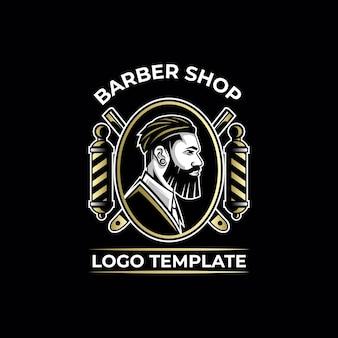 Modello di logo di lusso oro da barbiere