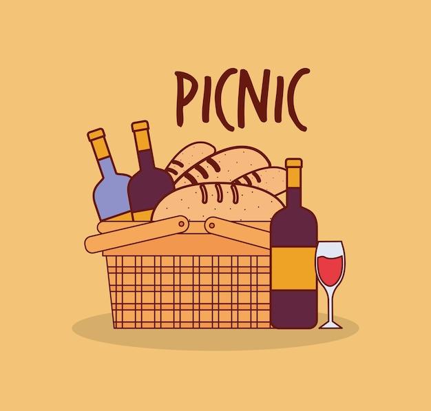 Cestino per un picnic con bottiglie e pane sotto un disegno dell'illustrazione dell'iscrizione del picnic