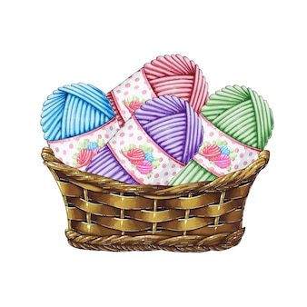 Cesto con gomitoli di lana per lavorare a maglia
