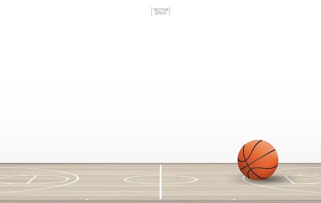 Sfera di pallacanestro sul campo da basket con pattern di pavimento in legno e texture
