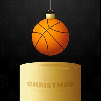 Piedistallo per palline di natale da basket. cartolina d'auguri di buon natale sportivo. appendi una palla da basket a filo come una palla di natale su un podio dorato su sfondo nero. illustrazione vettoriale di sport.