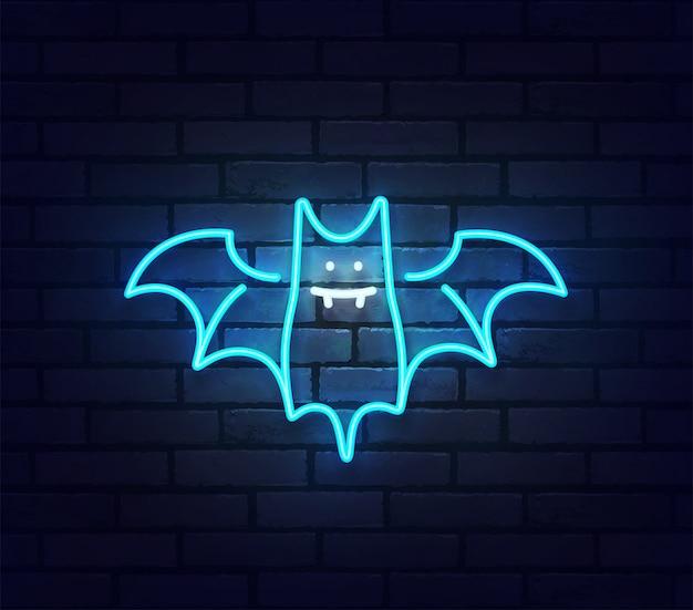 Insegna al neon di pipistrello. insegna luminosa della luce al neon isolata sul muro di mattoni.