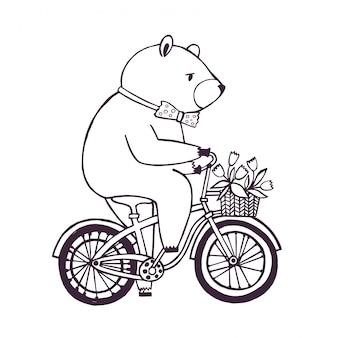 Orso sulla bicicletta con cesto e fiori.