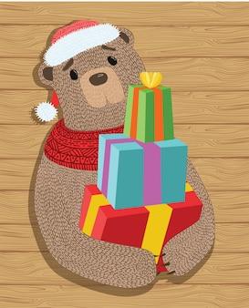 Orso con regali. illustrazione di un orso di natale del fumetto con i regali.