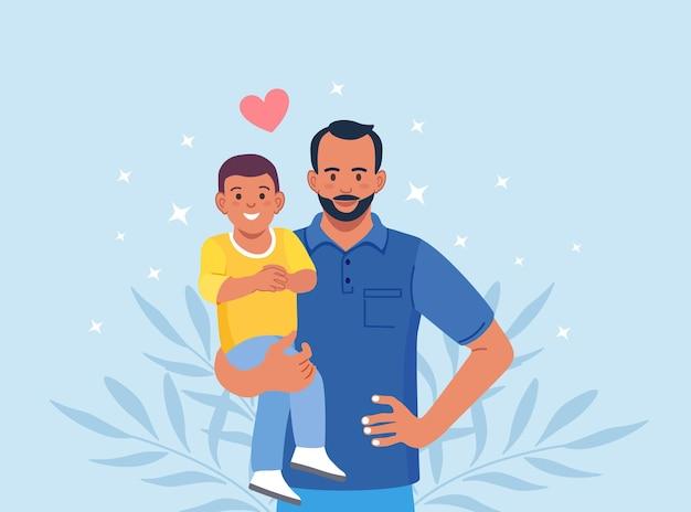 Uomo barbuto che porta ragazzo. il giovane padre tiene suo figlio con cura e amore. buona festa del papà. papà sorridente che tiene in braccio il figlio