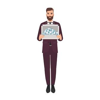 Uomo barbuto vestito con un elegante completo da lavoro che tiene in mano una valigetta piena di soldi