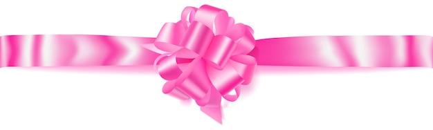 Bellissimo grande fiocco orizzontale fatto di nastro rosa con ombra su sfondo bianco