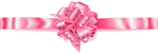 Bellissimo grande fiocco orizzontale fatto di nastro rosa con piccoli cuori lucidi con ombra su sfondo bianco
