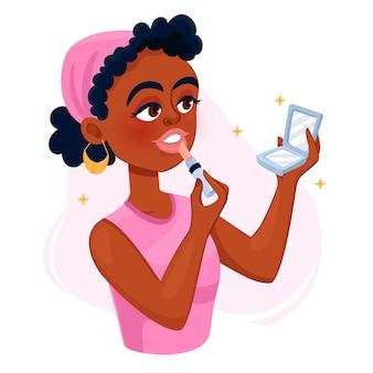Bella donna nera che applica rossetto rosa