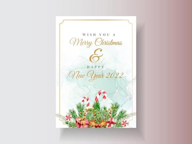 Bellissimo modello di carta con acquerello ornamento floreale e natalizio